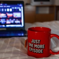 Netflix cup and laptop